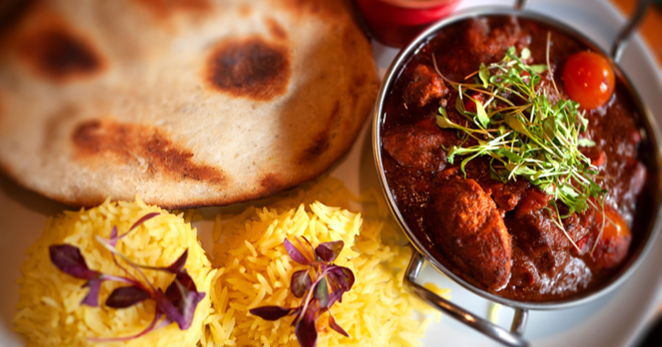 Indian meal with rice, curry and naan bread
