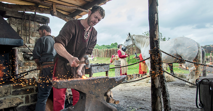 black smith working at the Viking Village in Kynren, County Durham.