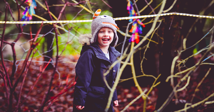 young boy enjoying Beamish Hall Hotel's Adventures in Wonderland woodland trail
