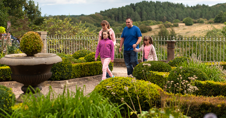 Family walking through a garden at Beamish Museum
