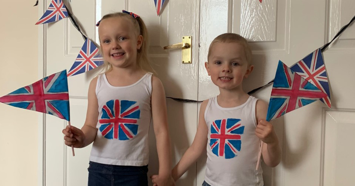 St Cuthbert's Roman Catholic Primary School and Nursery pupils Mae and Charlie McLean celebrate VE Day at home