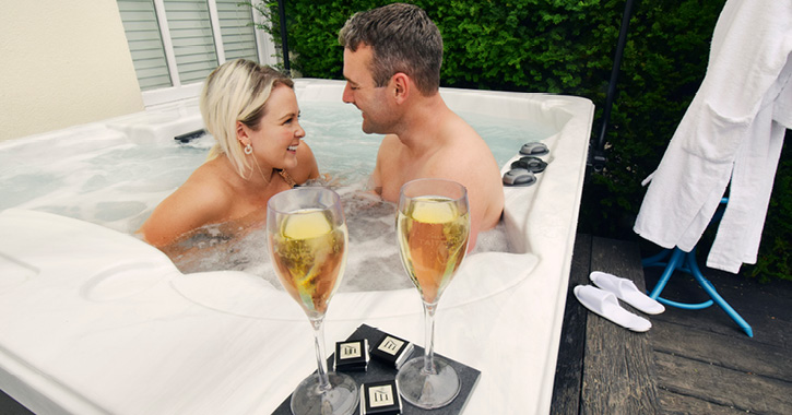 man and woman in hot tub at Seaham Hall Hotel