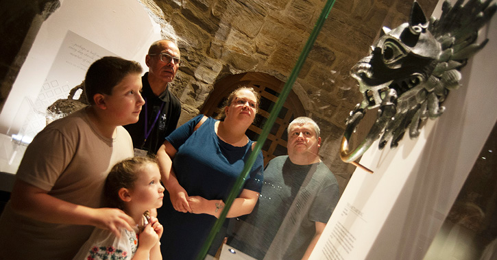 Family admiring a piece in Open Treasure at Durham Cathedral
