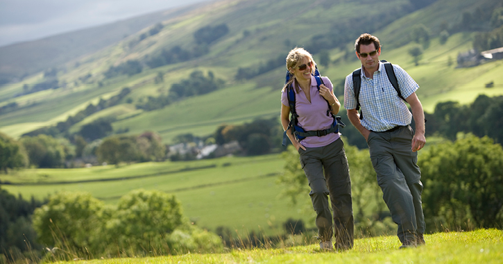 A couple walking in the countryside in County Durham.