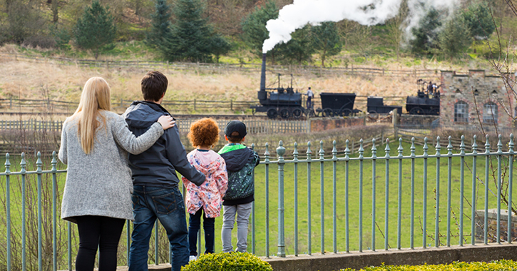 family watching steam engine at Beamish Museum