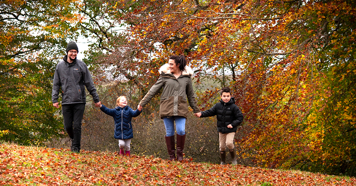 family of four enjoying an autumn walk in the Durham Dales