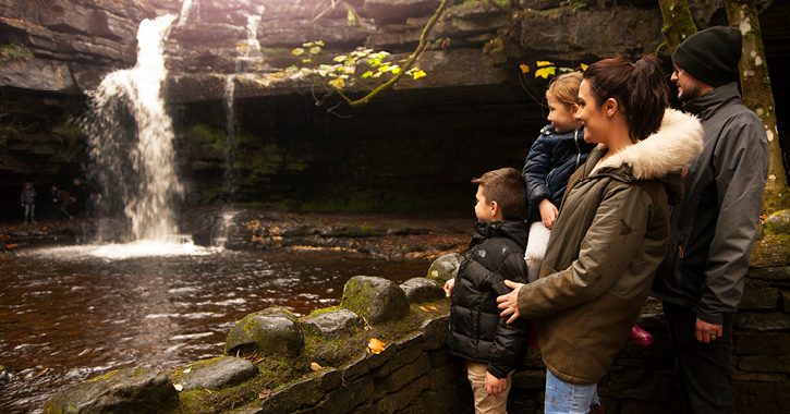 family stood admiring Gibson's Cave in the Durham Dales and North Pennines AONB