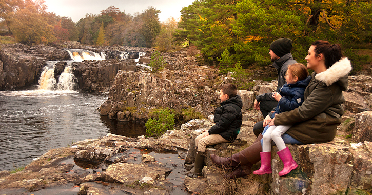 family sat watching Low Force Waterfall