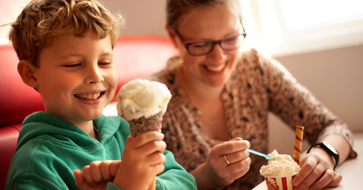 mother and son smiling whilst eating ice cream
