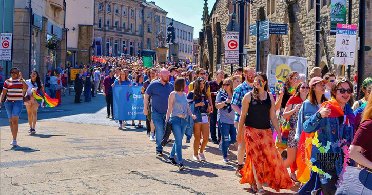 Durham pride parade making its way from durham cathedral to the sands
