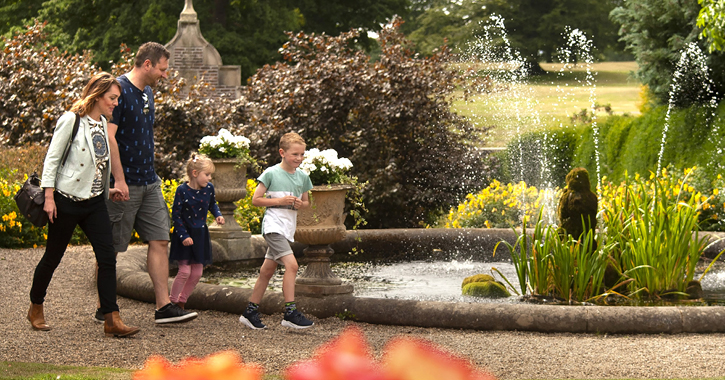 family walking through Raby Castle walled gardens