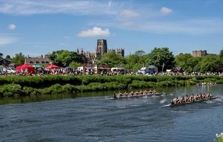 Image of Durham Regatta, Cathedral in Background, Sunny, Men's Boat Race, Array of Attractions on the Riverbanks