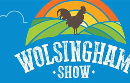 Wolsingham show 2021. Vibrant Logo of Rolling Hills in Orange and Green against a Blue Backdrop.