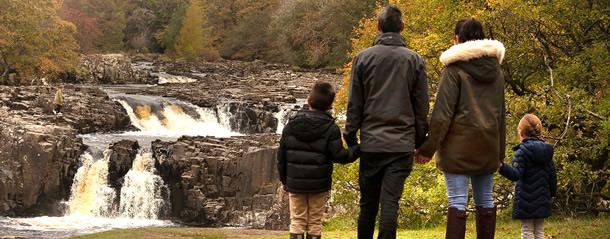 Low Force kids holding hands
