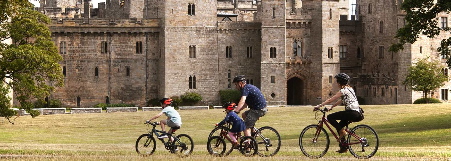 Raby Castle family on bikes