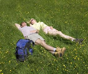 walkers lying in a haymeadow in County Durham.