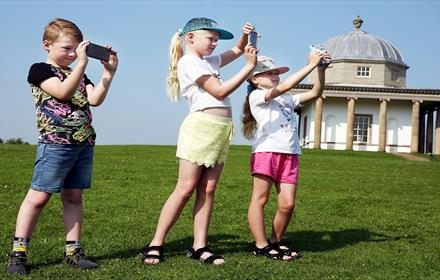 Three children at Hardwick Park using App