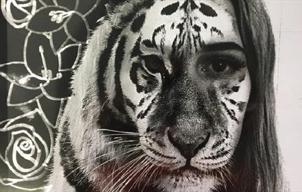 example of artwork in black and white an image of a tiger and woman with faces fused together
