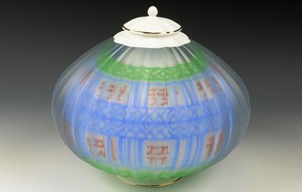 glass trinket box coloured blue and green with white lid